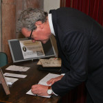 High Commissioner signs register